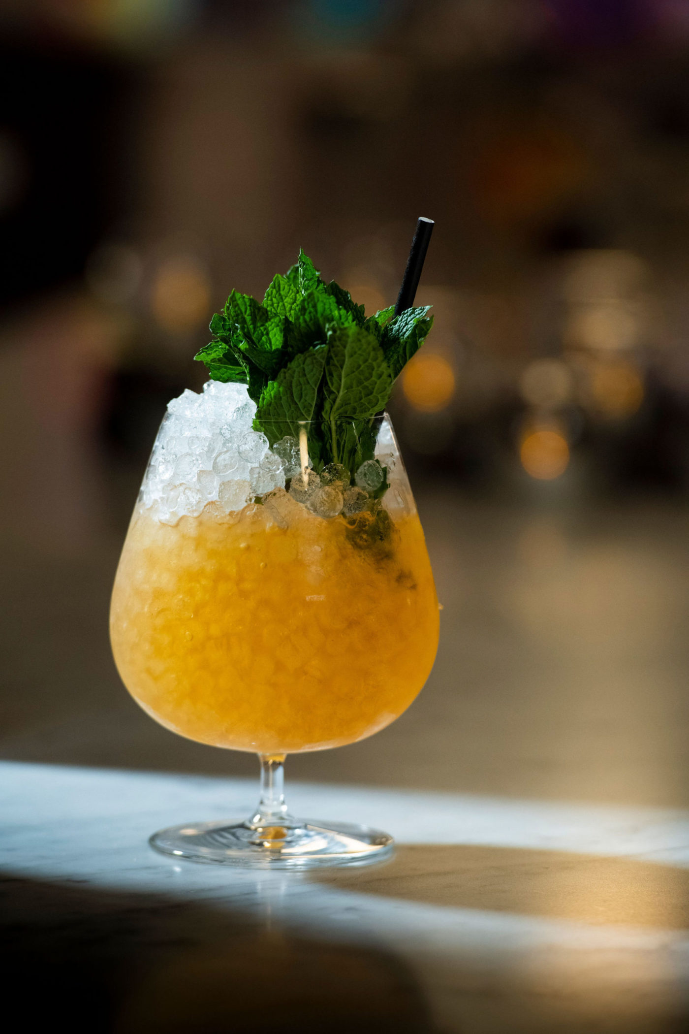 Orang Crushed Ice Drink with Mint Leaves On Bar