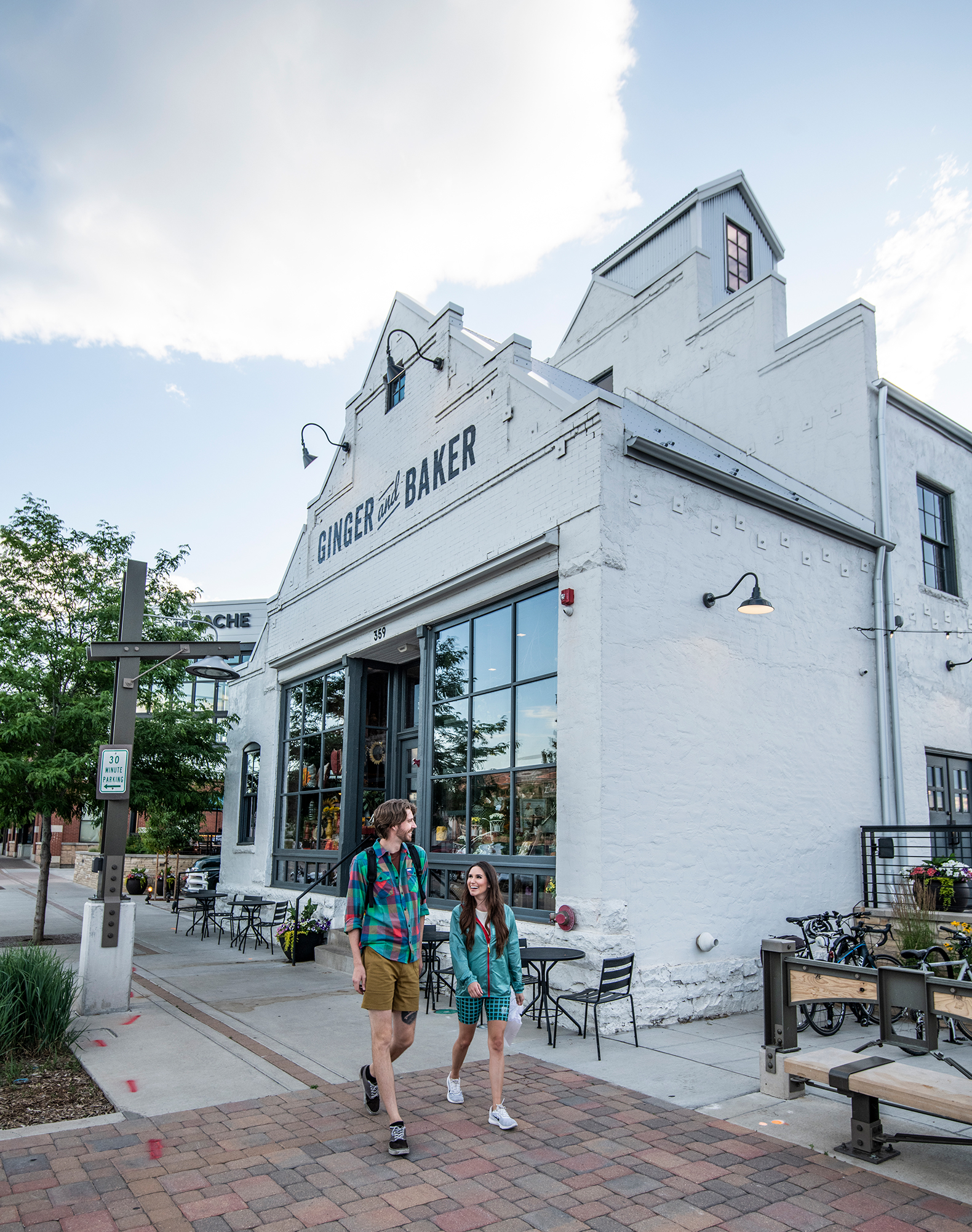 Couple walking in front of Ginger & Baker Restaurant in Fort Collins Colorado