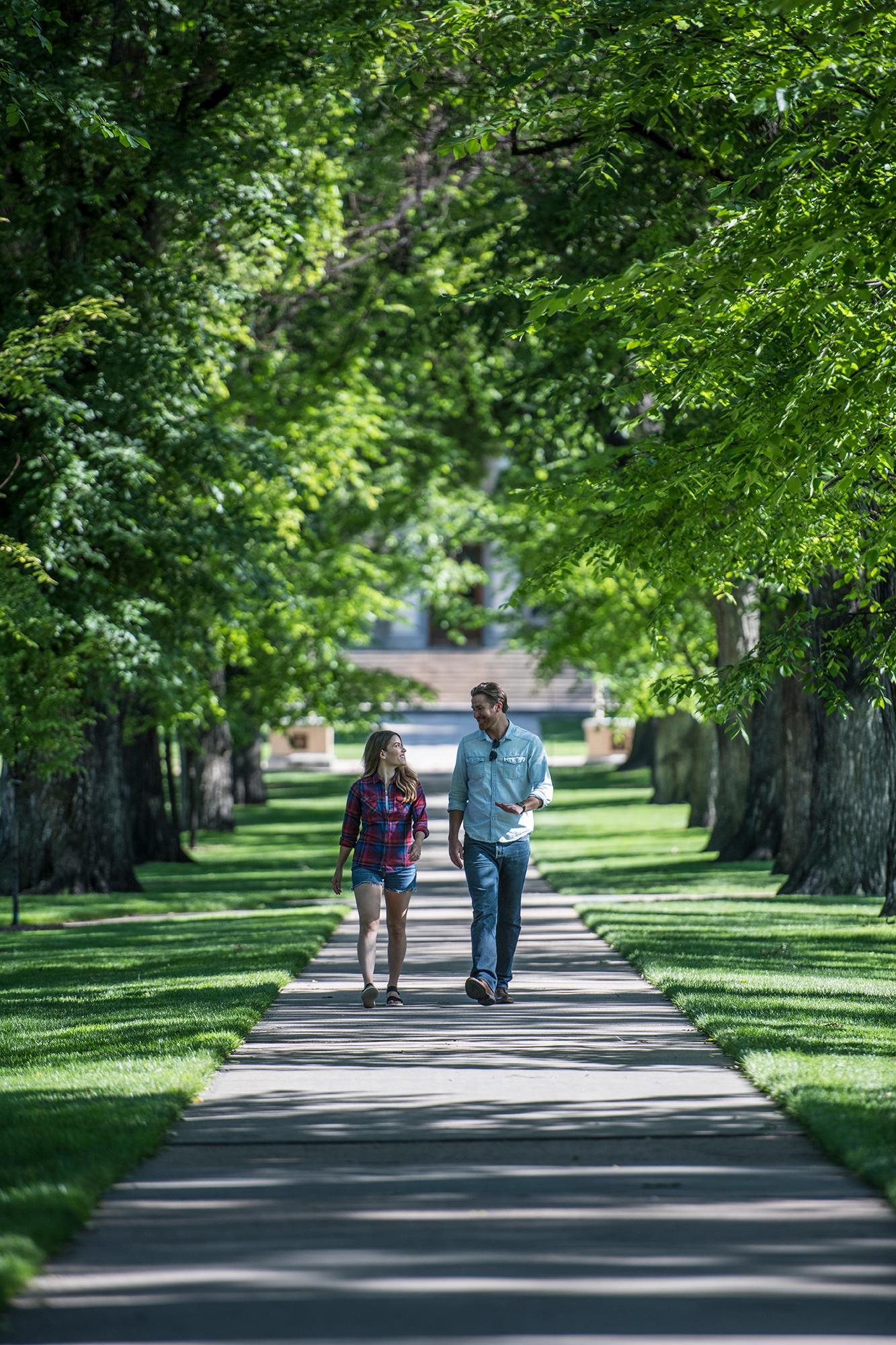 Couple walking through CSU Oval in summer