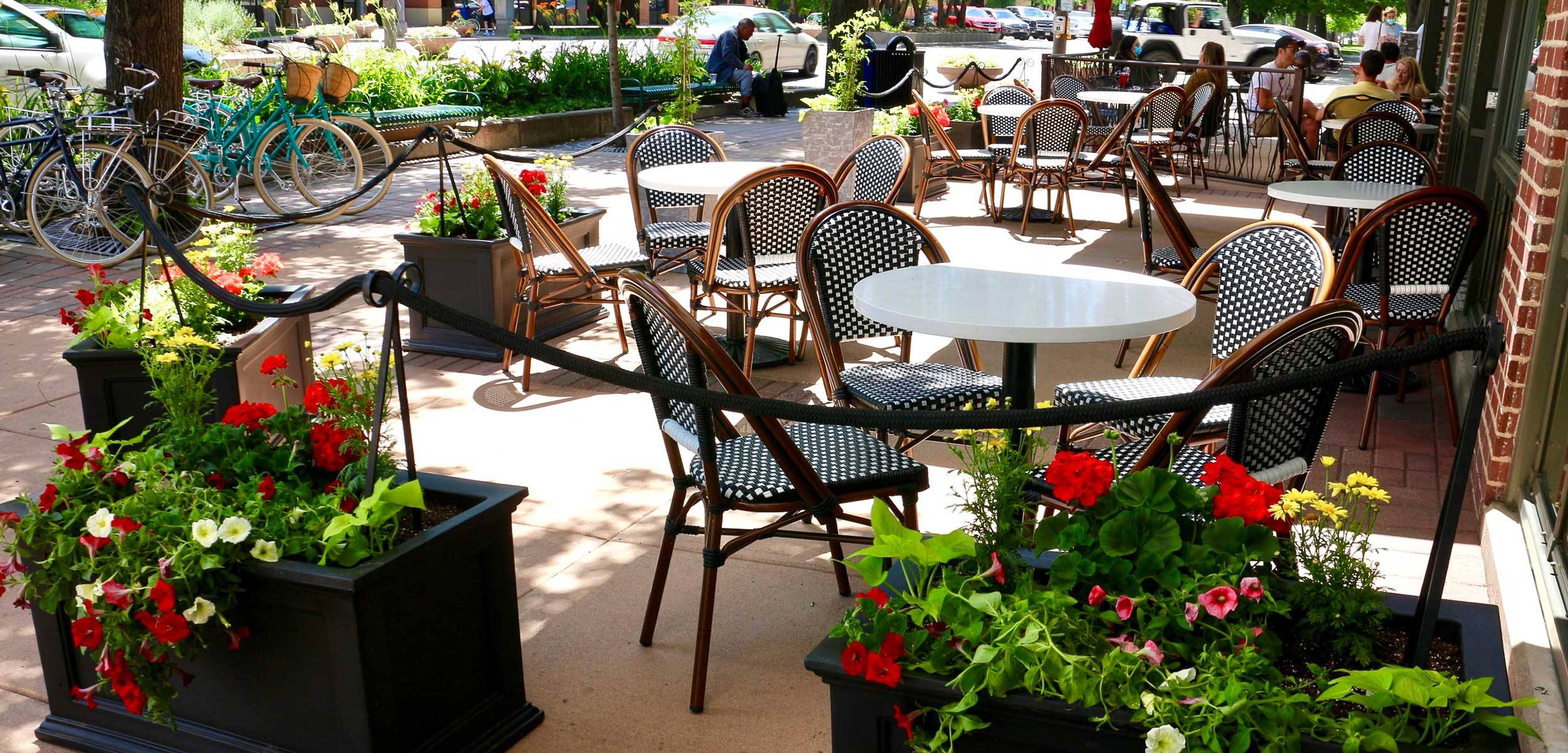 Ace Cafe outdoor tables with flowers in planters