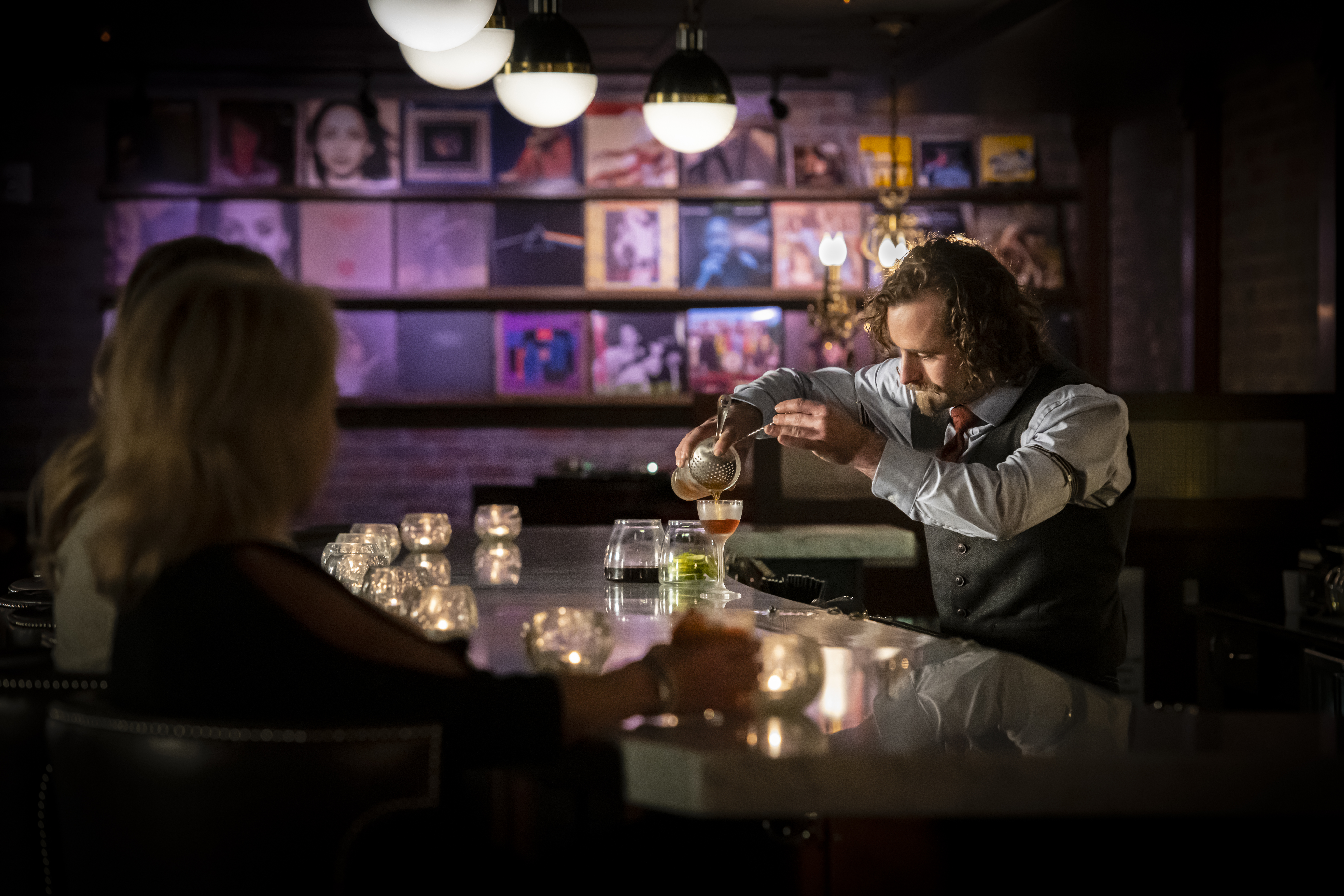 Ace Gillett;s Supper Club & Lounge bartender pouring drink